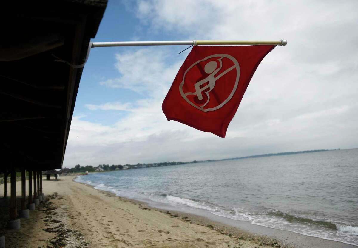 The beach is closed the day after Tropical Storm Henri hit Greenwich Point Park in Old Greenwich, Conn. Monday, Aug. 23, 2021. Henri doused the area with rain but left minimal damage as the hurricane was downgraded to a tropical storm before making landfall.