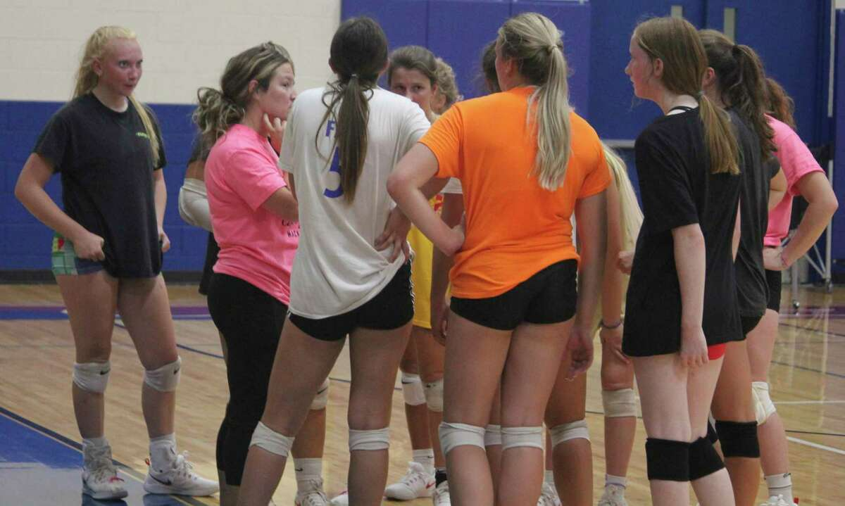 Chippewa Hills volleyball coach Hali Williams (second from left) talks to her team during a practice last week. (Pioneer photo/John Raffel)