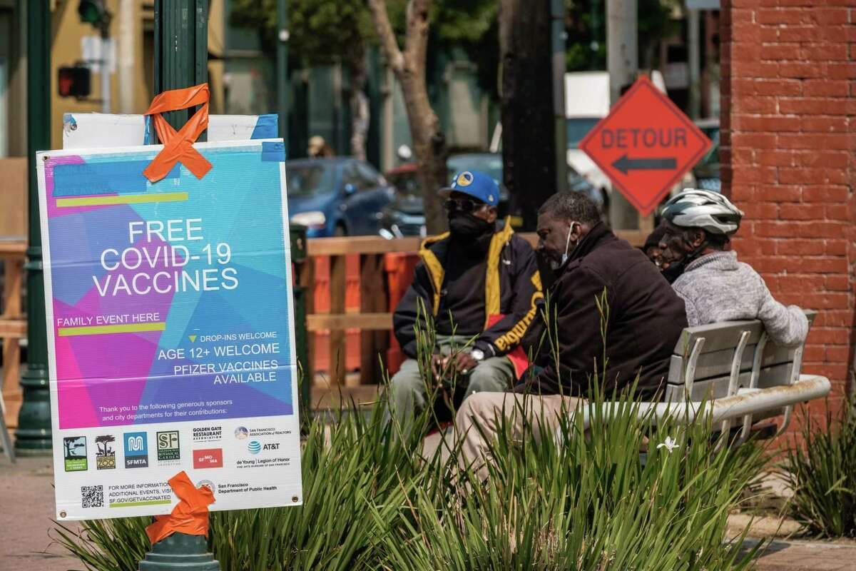 A poster advertising free COVID-19 vaccinations is seen in the Filmore District in San Francisco prior to the start of a press conference to highlight the city's mobile vaccination efforts and encourage residents to get vaccinated against COVID-19.