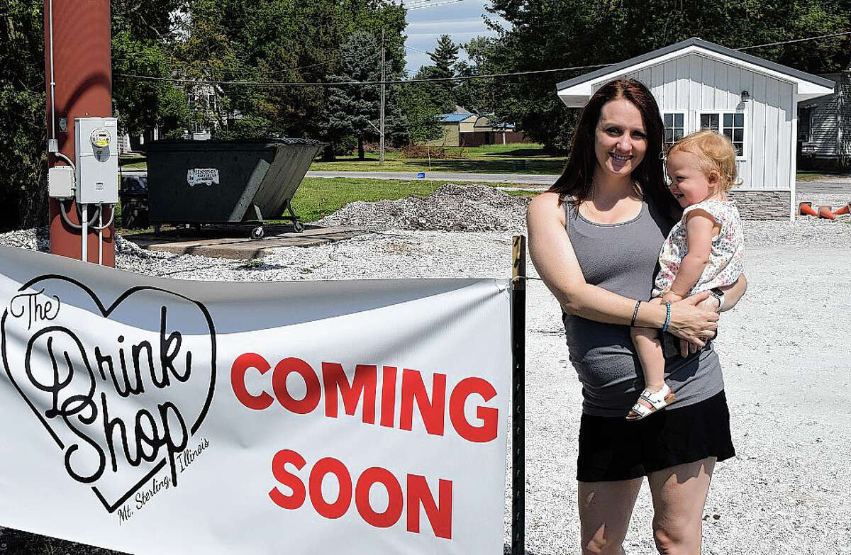 Kimberly Kestner and her daughter, Kynlee Kestner, stand near their new business, The Drink Shop, which is set to open soon in Mount Sterling. A portion of the profits will go to heart health-related charities.