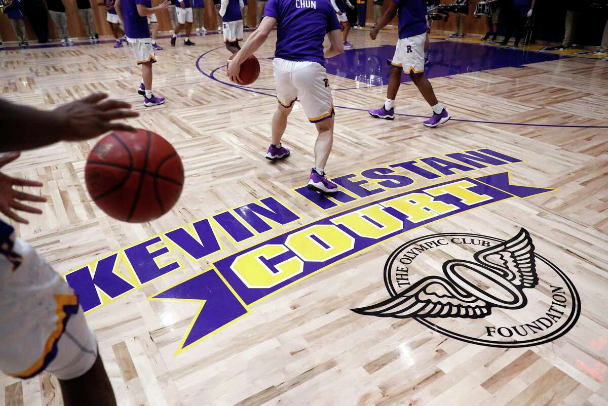 Archbishop Riordan High School basketball team warms up before playing St. Ignatius on Restani Court, honoring Kevin Restani, a 1970 Riordan graduate who starred at USF and in the NBA.