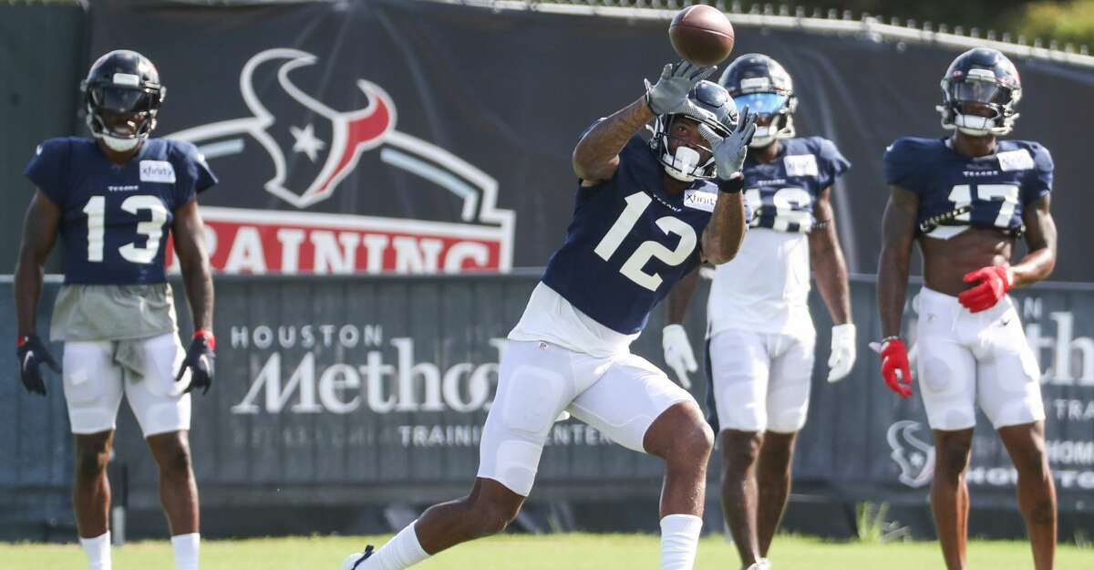 Houston Texans wide receiver Nico Collins (12) reaches out to make a catch during an NFL training camp football practice Monday, Aug. 9, 2021, in Houston.