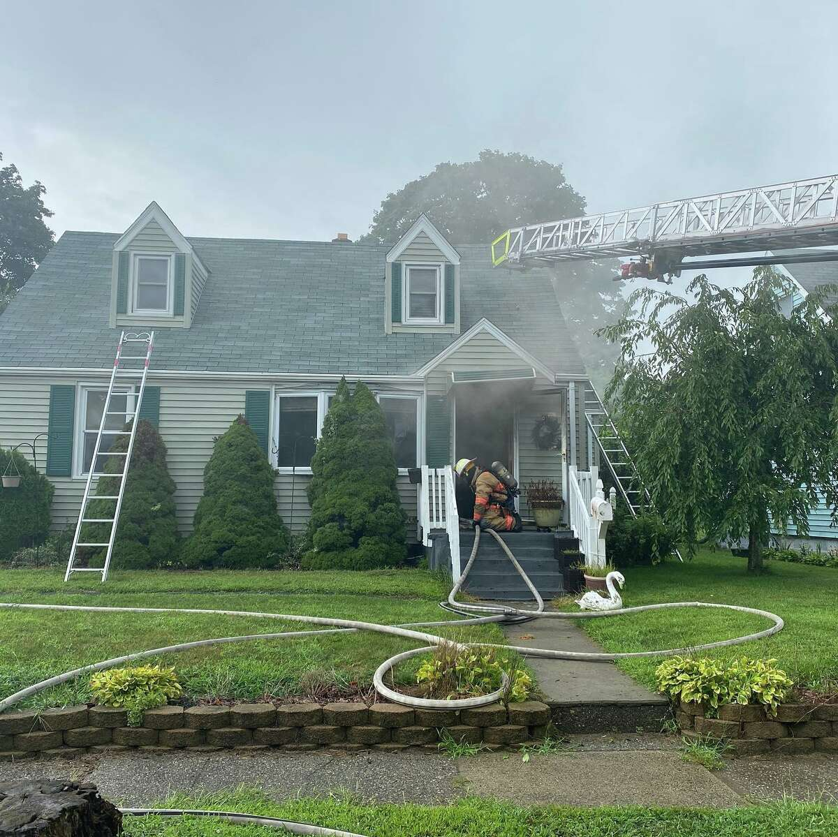 Milford firefighers work to put out a fire at a home on Alden Place Monday, Aug. 23, 2021.