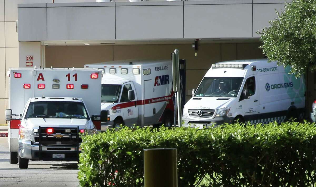 Ambulances line up outside the emergency entrance of Memorial Hermann Greater Heights Hospital in Houston on Friday, Aug. 20, 2021.