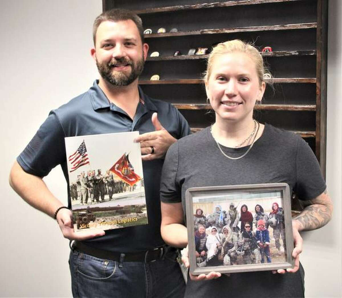 Bradley Yount, left, and Torie Ryan are veterans service officer benefit specialists with the Madison County Veterans Assistance Commission. Yount was a Marine satellite communications specialist and Ryan served as a medic with the 101st Airborne. Both are veterans of Afghanistan and talked about their experiences and feelings as the U.S. pulled out of the country last week.