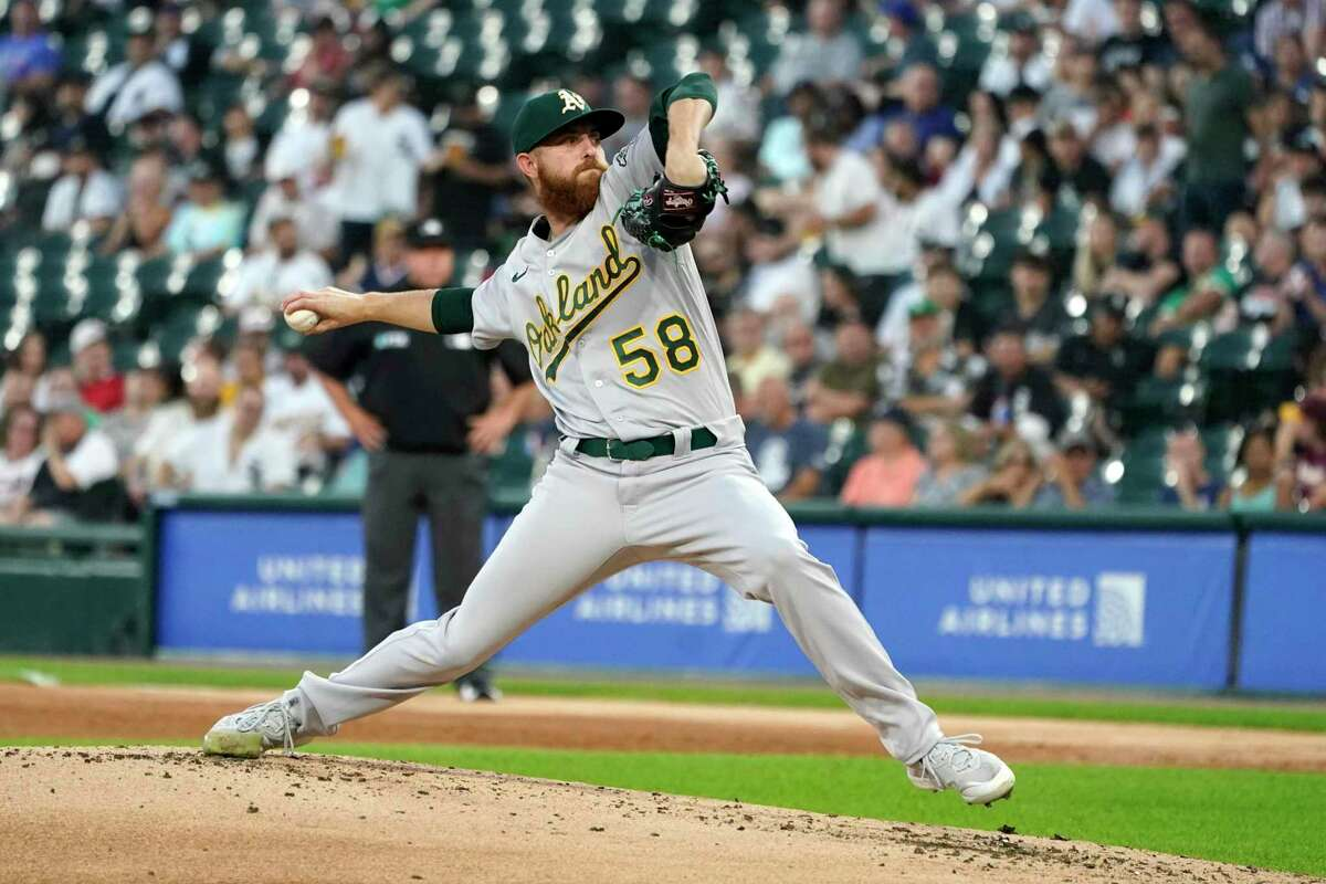 Oakland Athletics starting pitcher Paul Blackburn delivers during the first inning of the team's baseball game against the Chicago White Sox on Wednesday, Aug. 18, 2021, in Chicago. (AP Photo/Charles Rex Arbogast)