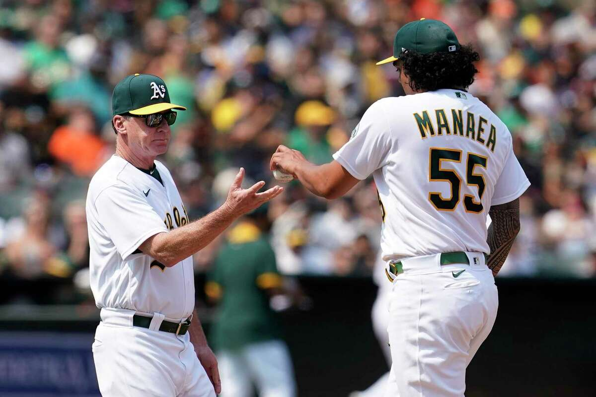 Oakland Athletics starting pitcher Sean Manaea (55) hands the ball to manager Bob Melvin as he is taken out for a relief pitcher during the fifth inning of the team's baseball game against the San Francisco Giants in Oakland, Calif., Saturday, Aug. 21, 2021. (AP Photo/Jeff Chiu)