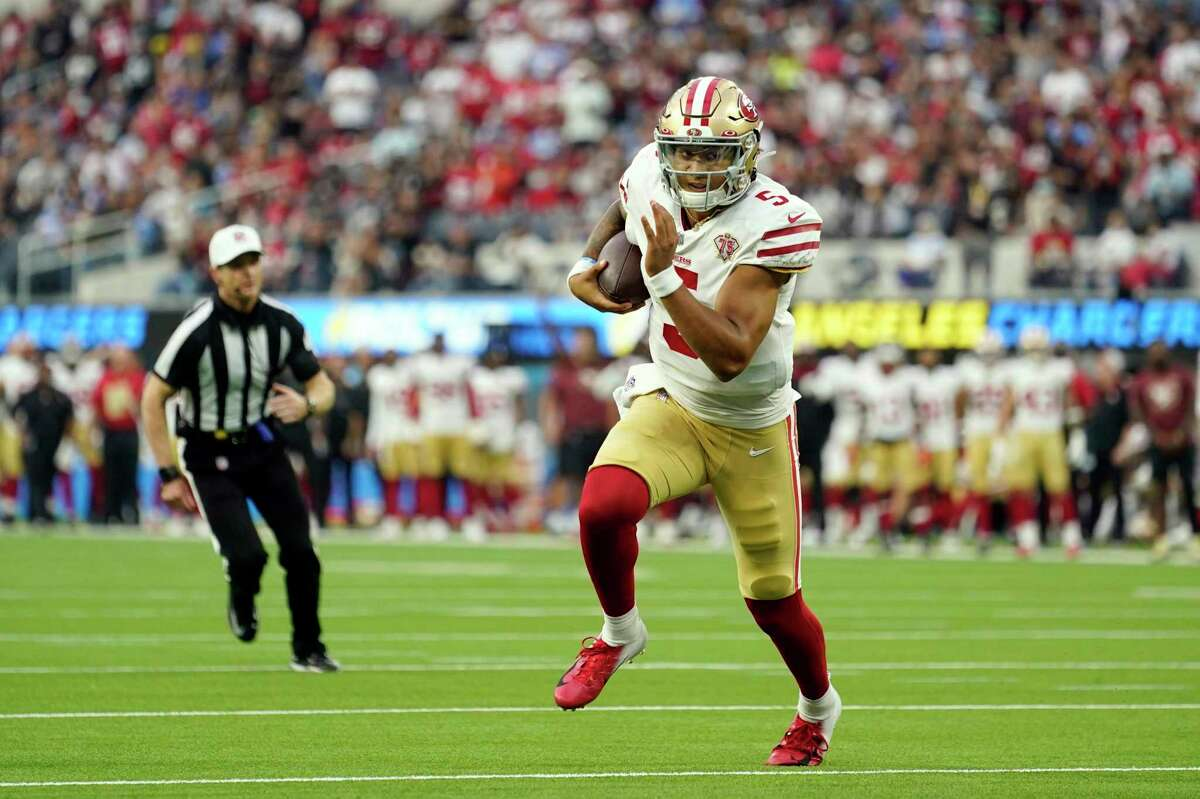 San Francisco 49ers quarterback Trey Lance runs against the Los Angeles Chargers during the first half of a preseason NFL football game Sunday, Aug. 22, 2021, in Inglewood, Calif. (AP Photo/Ashley Landis)