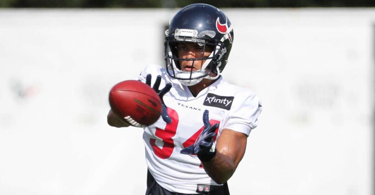 Houston Texans cornerback John Reid (34) runs a drill during an NFL training camp football practice Thursday, Aug. 12, 2021, in Houston.