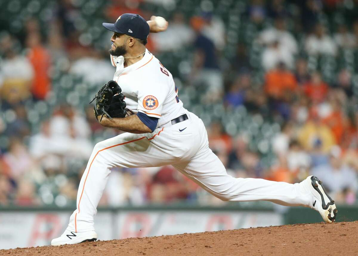 Houston Astros relief pitcher Yimi Garcia (93) pitches in the seventh inning against the Kansas City Royals at Minute Maid Park in Houston on Monday, Aug. 23, 2021.