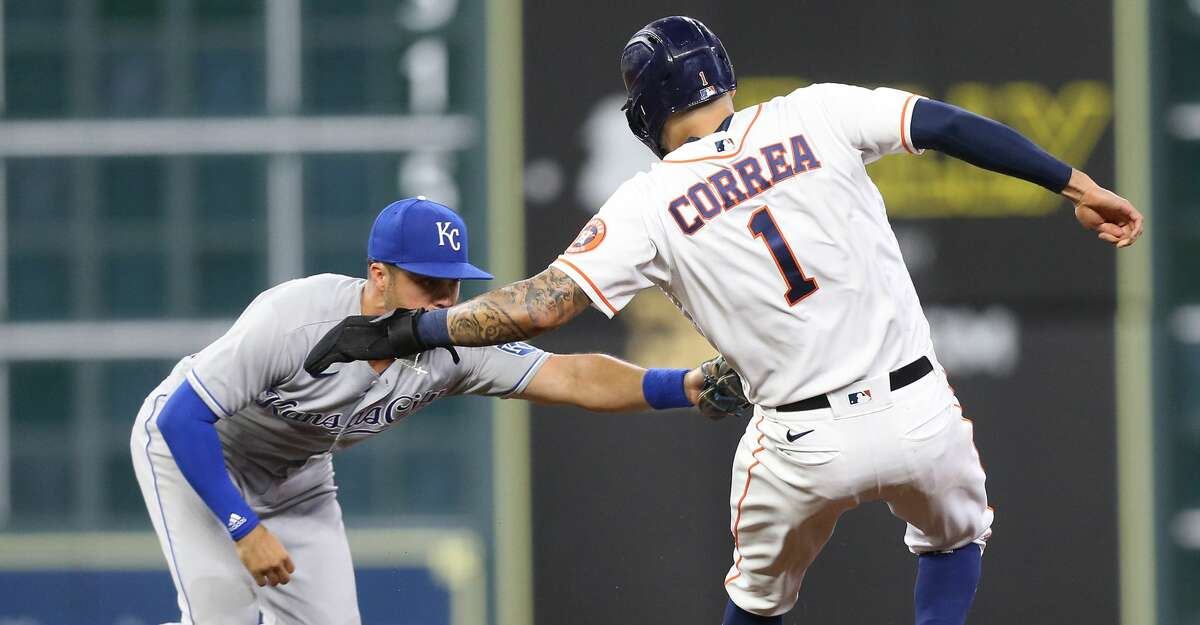 Kansas City Royals second baseman Whit Merrifield (15) gets Houston Astros shortstop Carlos Correa (1) out at second in the fourth inning at at Minute Maid Park in Houston on Monday, Aug. 23, 2021.