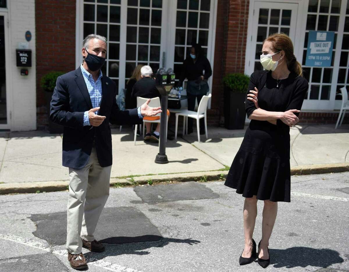Greenwich First Selectman Fred Camillo and Connecticut Lt. Gov. Susan Bysiewicz tour the southern end of Greenwich Avenue as folks dine outside of Mediterraneo in Greenwich, Conn. Monday, June 1, 2020.