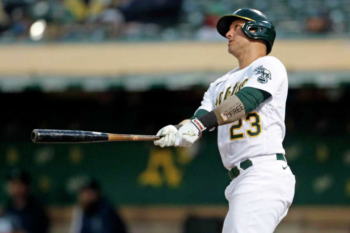 Oakland Athletics' Yan Gomes watches his 4th inning solo home run against Seattle Mariners during MLB game at Oakland Coliseum in Oakland, Calif., on Monday, August 23, 2021.