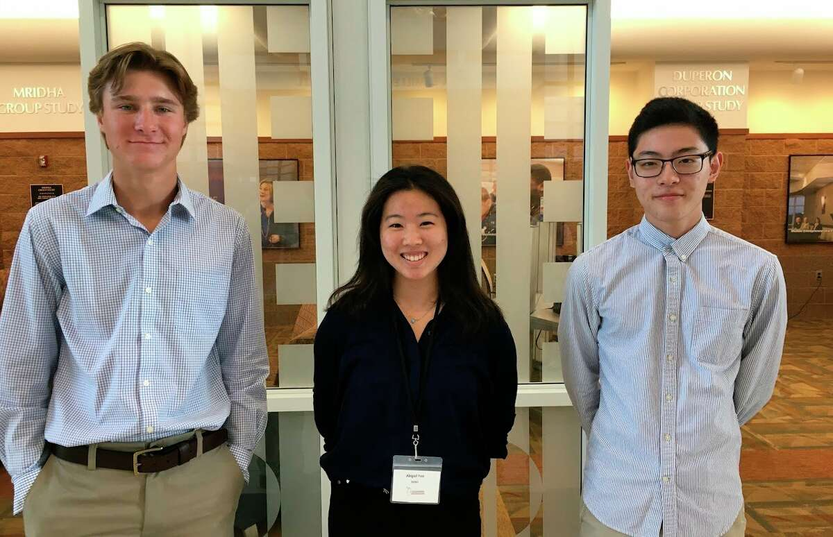 Midland Public School students pose for a picture. (Left to right)Midland High senior Carter Albright,H.H. Dow High student Abigail Yoo andH.H. Dow High student Josh Chae. (Photo Provided)
