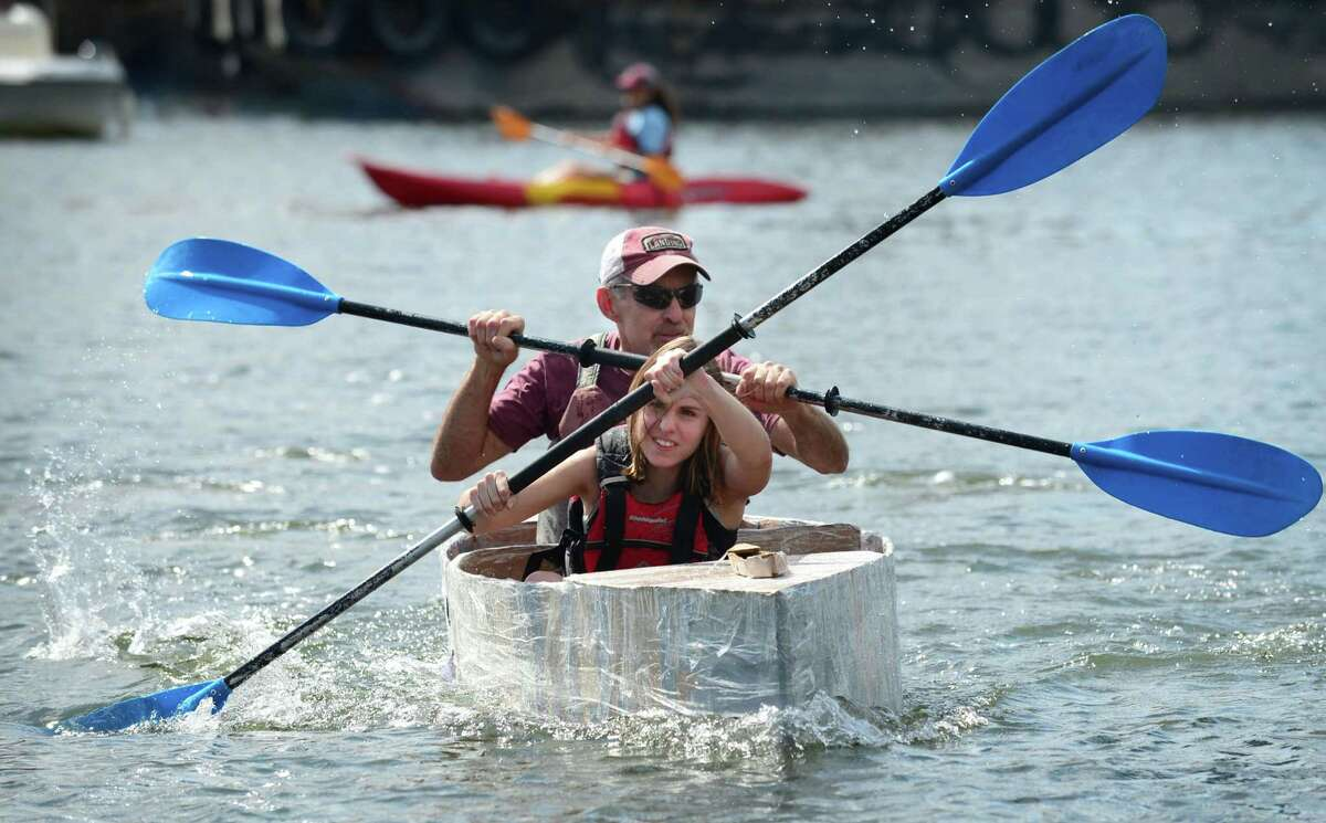 Chelsea Lovece and Tom Lovece paddle to win the Cardboard Kayak Race as SoundWaters hosts the fourth annual HarborFest on Saturday, August 24, 2019, at the Harbor Point Boardwalk in Stamford, Conn.