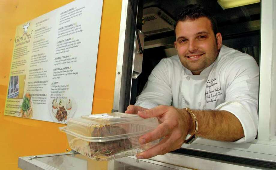 Chef Biagio Barone has opened the first of what he hopes will be a franchised business of gourmet food trucks. On Thursday September 16, 2010, Chef Barone poses inside the window of his new truck in Milford, Conn.. Photo: Christian Abraham / Connecticut Post