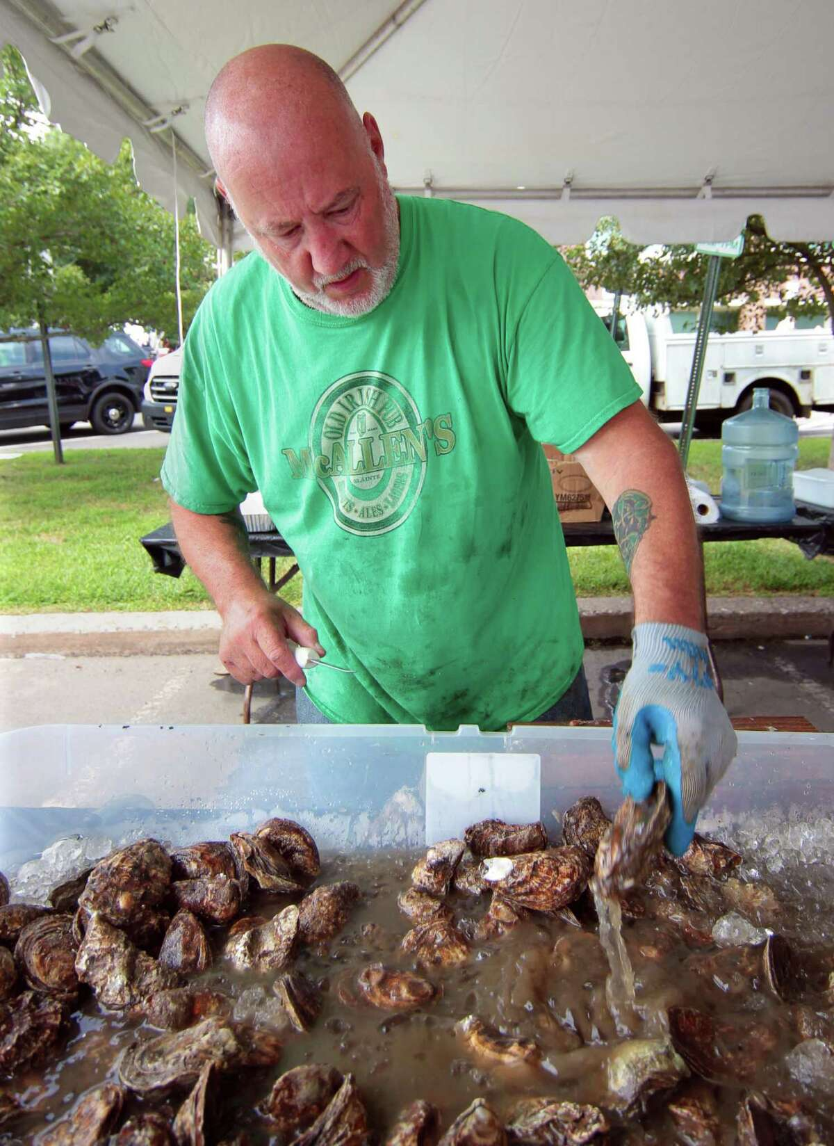 Dave McAllen shucks oysters during the 47th Annual Milford Oyster Festival in downtown Milford, Conn., on Saturday August 21, 2021.