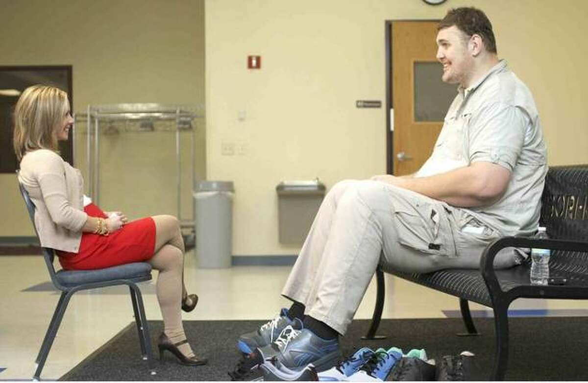 Igor Vovkovinskiy, the tallest man in the United States, is shown in a television interview in Duluth, Minnesota. Vovkovinskiy died in Minnesota on Friday; he was 38.