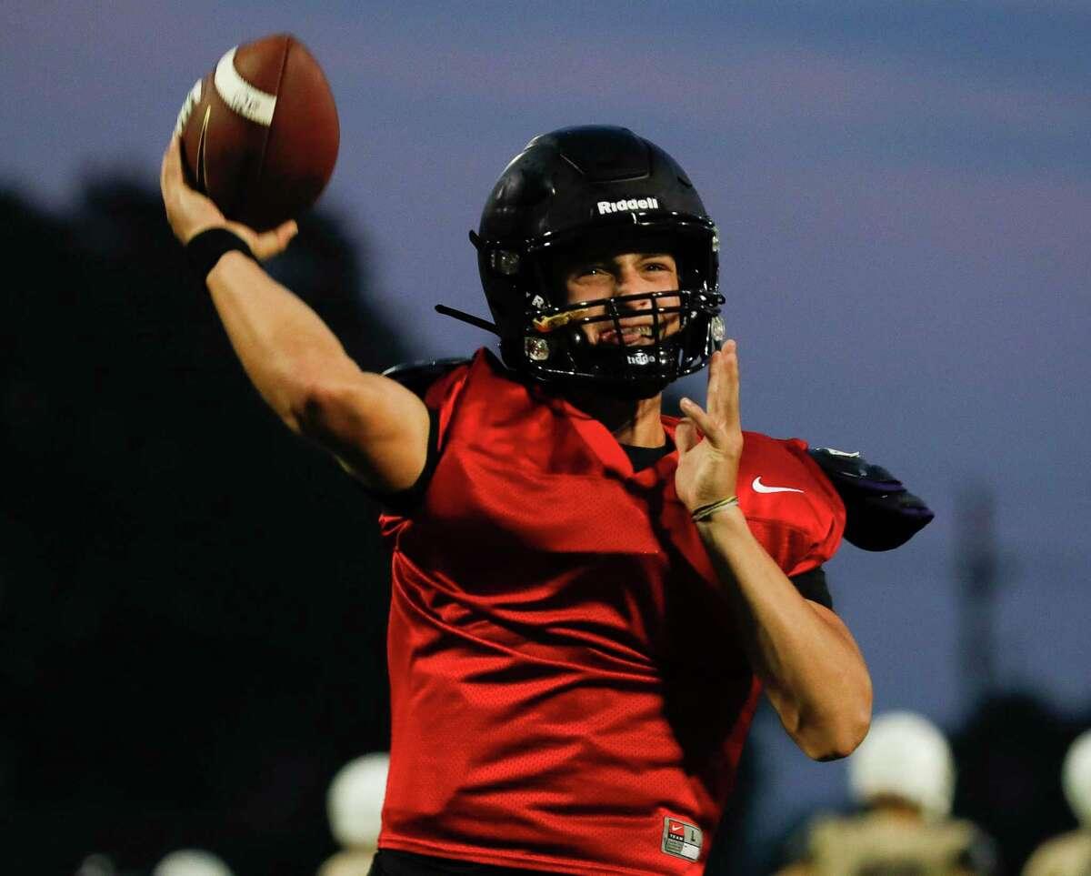 Conroe quarterback Clayton Garlock throws a pass during football practice at Buddy Moorhead Stadium, Wednesday, Aug. 4, 2021, in Conroe.