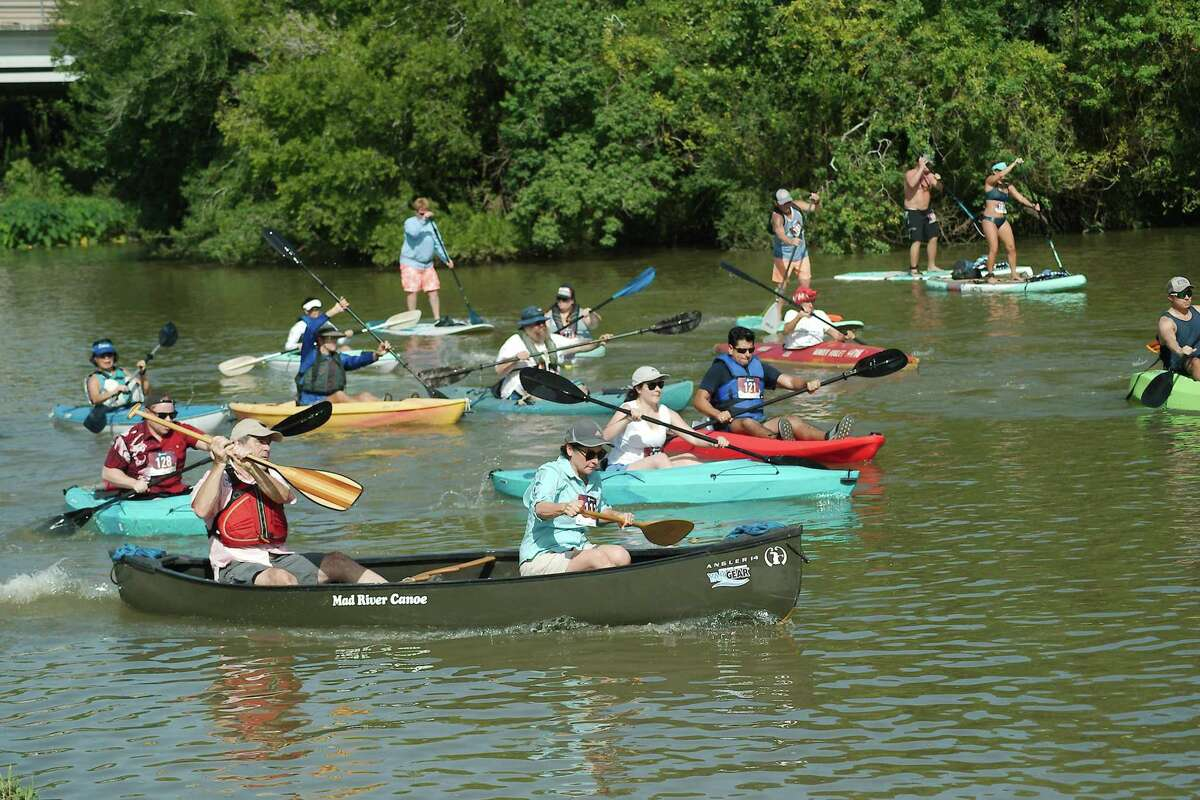 Paddle sport enthusiasts maneuver the 4.5 mile round trip during the Clear Creek Paddle Race in League City on Aug. 21. City officials say the creek has seen a surge in activity from boaters using canoes and kayaks.