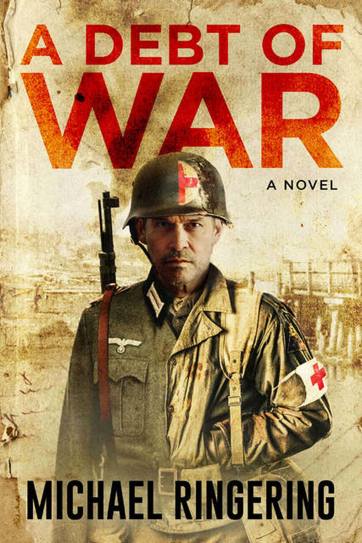 """East Alton native Michael Ringering has released his new novel, """"A Debt of War,"""" a work of historical fiction involving World War II that revolves around a dying wish and a mysterious manuscript that bring to light a soldier's undying commitment to pay a debt owed."""