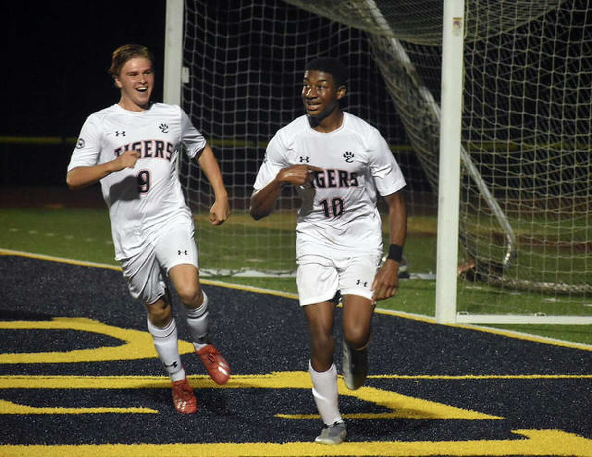 Edwardsville's Chris Agwuedu, right, celebrates with teammate Brendan James after scoring the go-ahead goal against Granite City midway through the second half on Monday in Belleville.