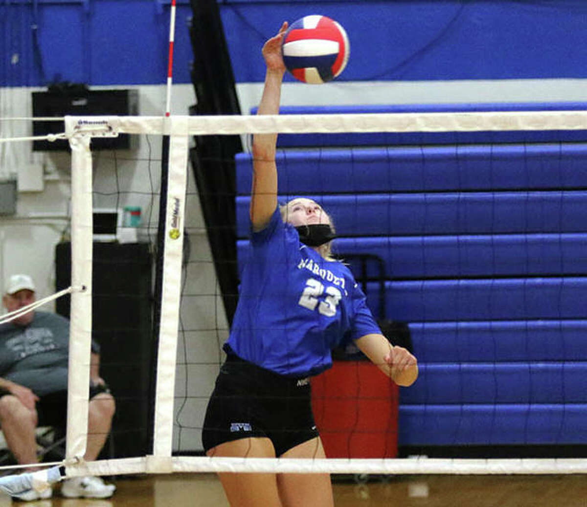 Marquette's Kylie Murray attacks for a kill during a two-set victory over EA-WR at the Roxana Tournament on Monday night.