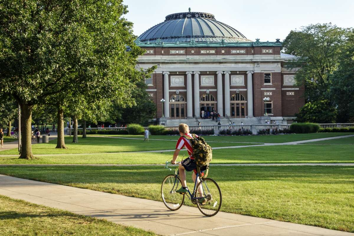Student riding bicycle on campus of the University of Illinois. (Photo by Jeffrey Greenberg/Universal Images Group via Getty Images)