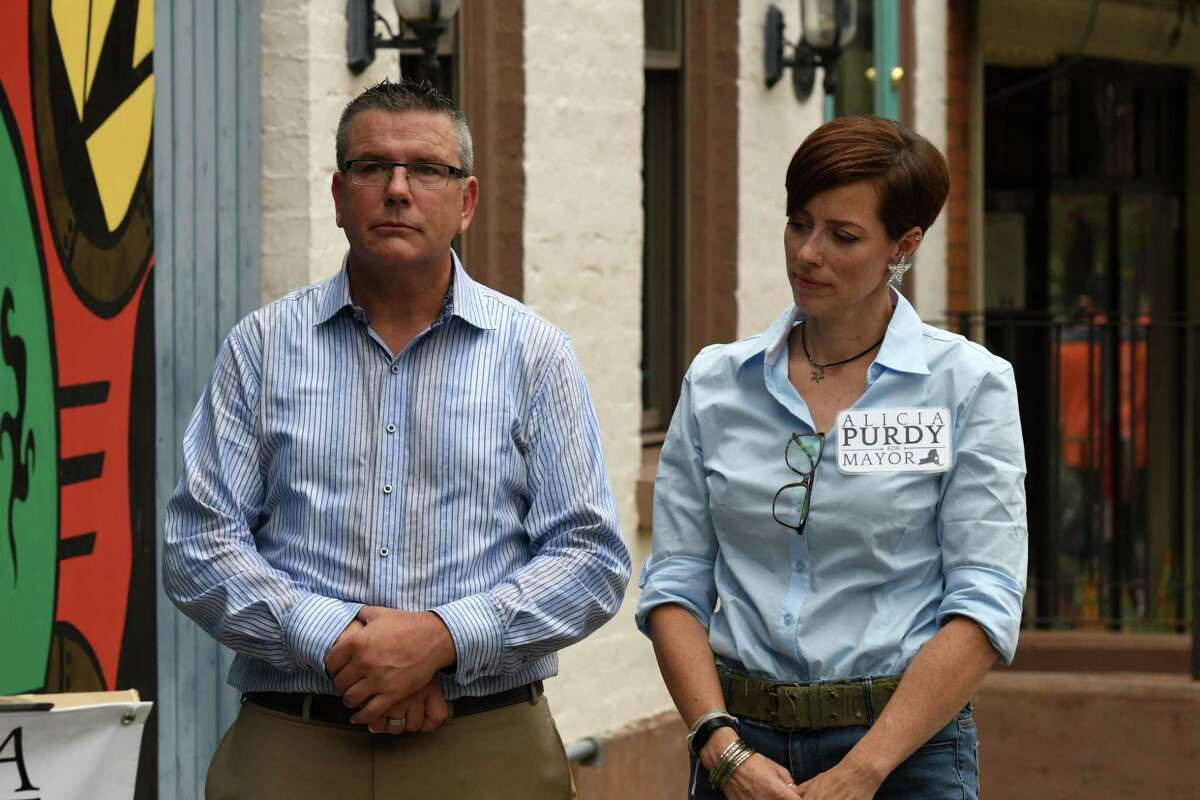 Cafe Hollywood owner Colin Rost, left, stands outside his Lark Street establishment with Republican Albany mayoral candidate Alicia Purdy, right, during a press conference held by in support of the bar, which the city shut down last month in response to escalating violence on Tuesday, Aug. 24, 2021, in Albany, N.Y.