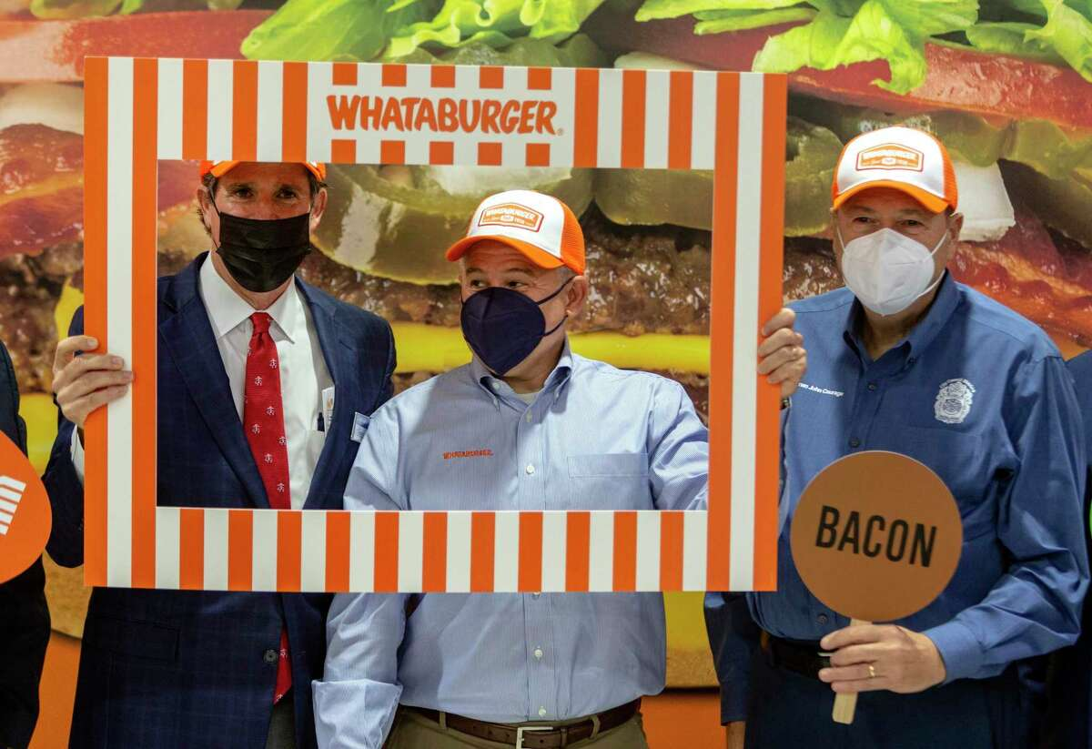 Gregg Paradies, Paradies Lagardre President and CEO, from left, Ed Nelson, Whataburger CEO, and John Courage, San Antonio District 9 councilman, pose Tuesday morning, Aug. 24, 2021 at the San Antonio Airport after a news conference announcing Whataburger would be opening a store in Terminal B. Whataburger enters the airport after the 2019 controversy surrounding the City of San Antonio's controversial handling of a Chick-fil-A restaurant at the same location.