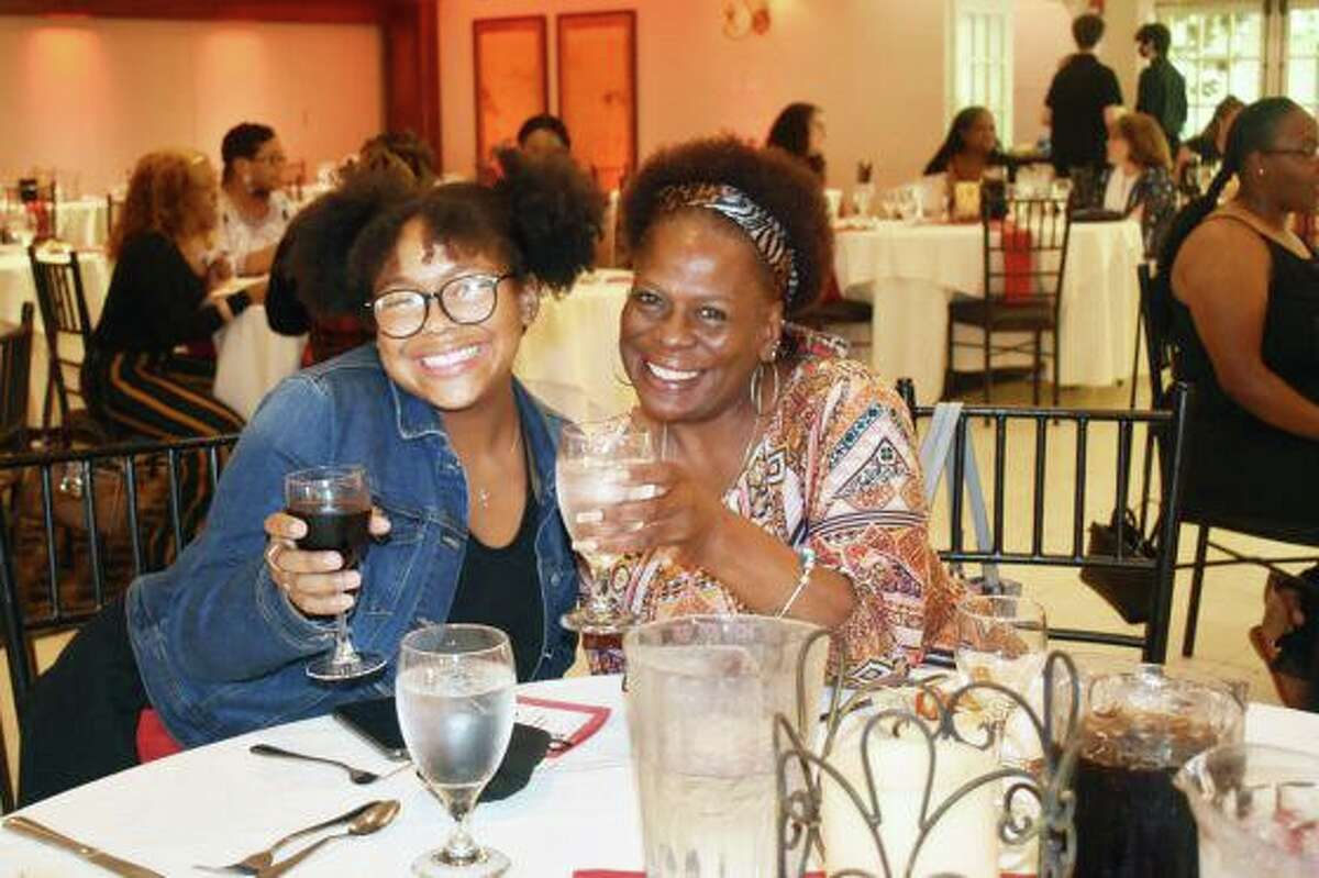Mikayla Chalmers, left, who graduated from Middletown High School and Wesleyan's Upward Bound Math-Science program in June, celebrates her success with her mother, Carolyn Wright.