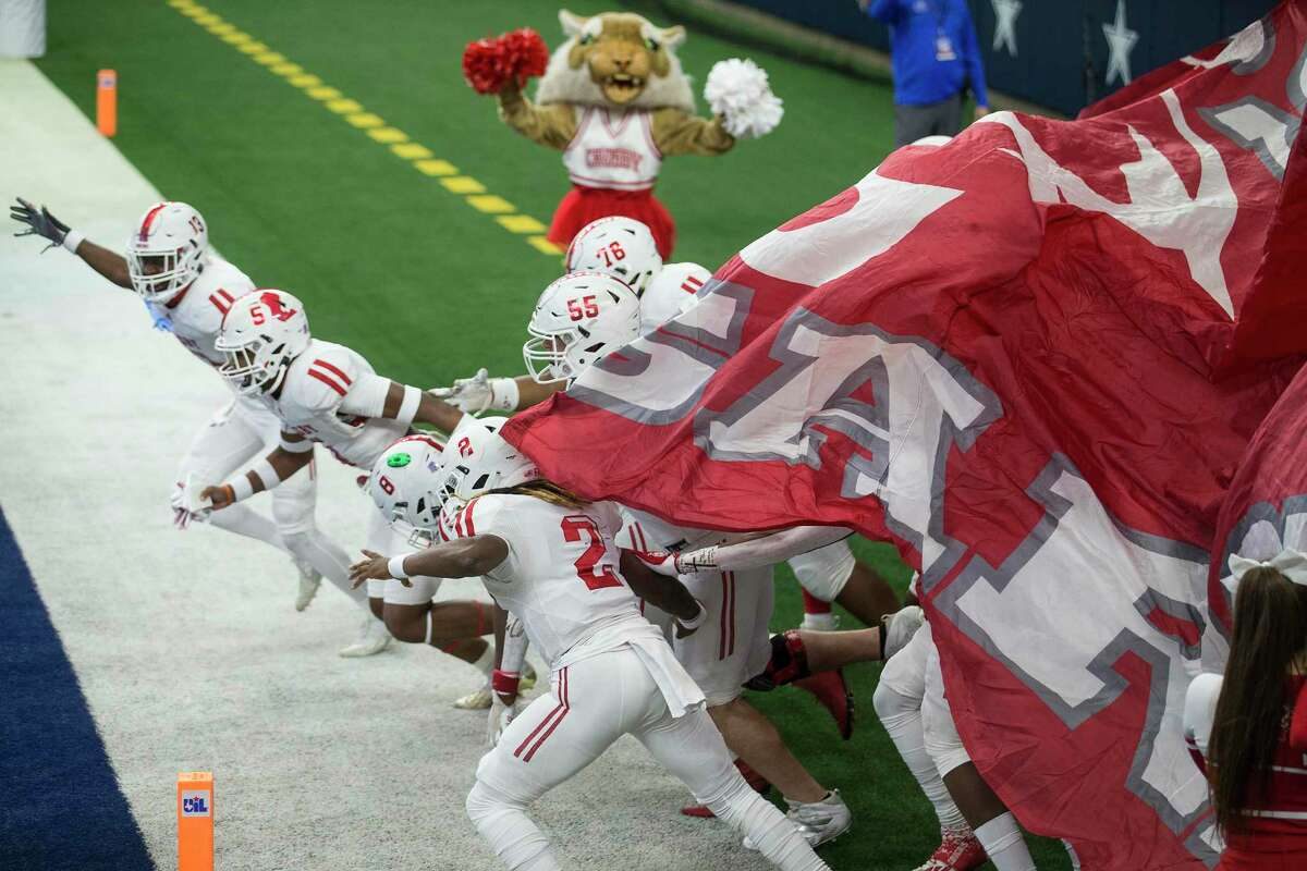 Crosby players run onto the field for the Class 5A Division II UIL State Championship high school football game against Aledo at AT&T Stadium Friday, Jan. 15, 2021, in Arlington, Texas.