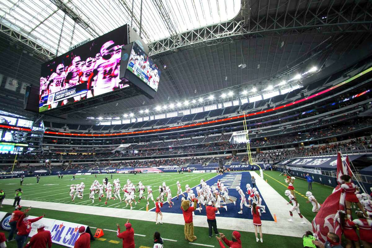 Crosby players run onto the field for the 5A Division II UIL State Championship high school football game against Aledo at AT&T Stadium Friday, Jan. 15, 2021, in Arlington, Texas.