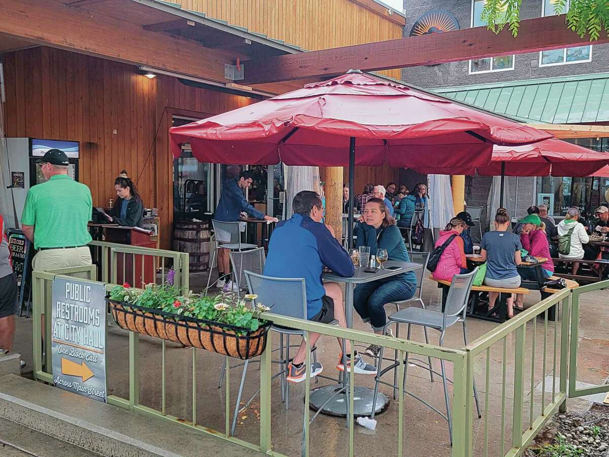People eat in the outdoor dining area at Stormcloud Brewing Company in June. Restaurants, hotels in Benzie County and beyond are expected to see a large increase in business during the weekend of September for the Ironman event in Frankfort. (File photo)
