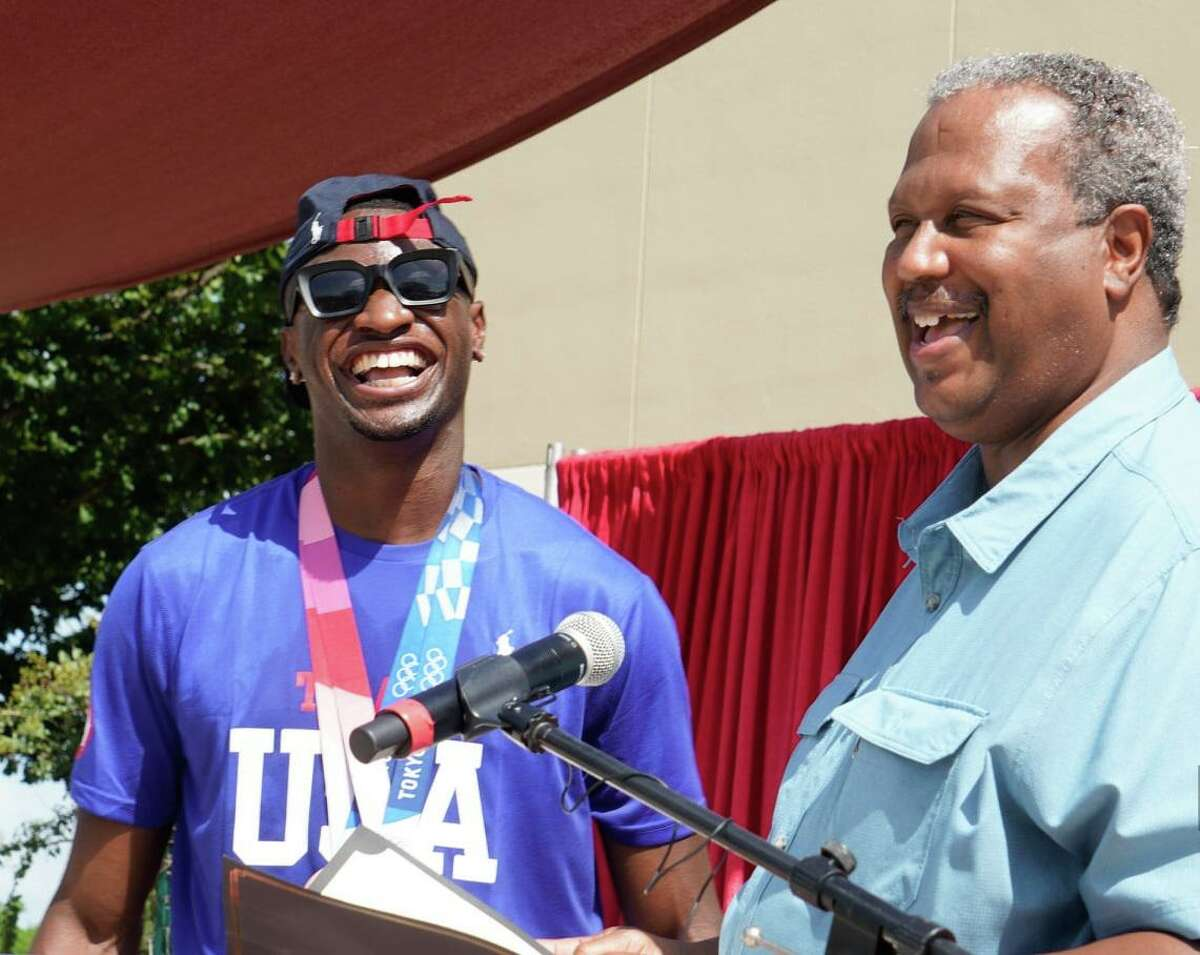 Fort Bend County Commissioner Grady Prestage, right, presents Olympic medalist Bryce Deadmon with a proclamation at a celebration on Saturday, Aug. 21, at Community Center Plaza in Missouri City.