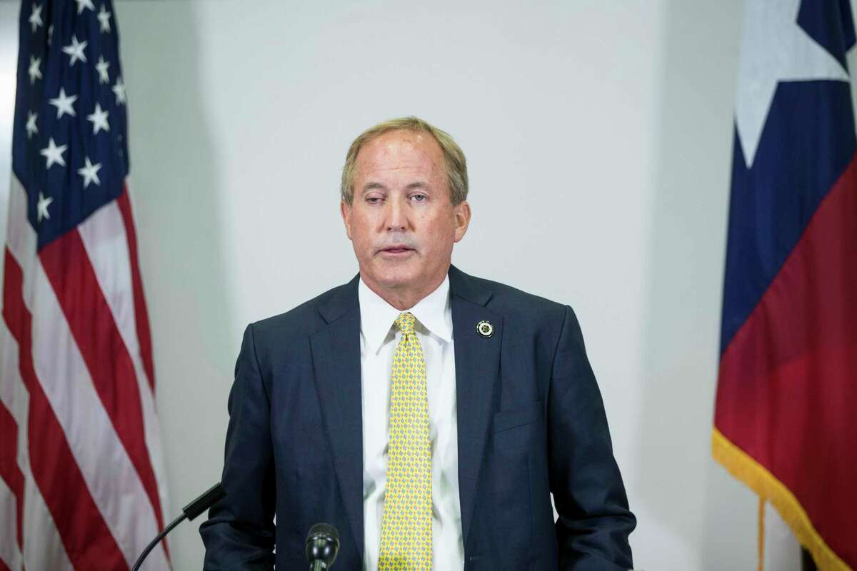 The office of Texas Attorney General Ken Paxton, shown at a Aug. 5, 2021 news conference in Houston, released an internal report on Aug. 24, 2021 that found Paxton did not accept bribes and did not misuse his office to benefit his friend and campaign donor Nate Paul, despite a continuing FBI investigation of the matter.