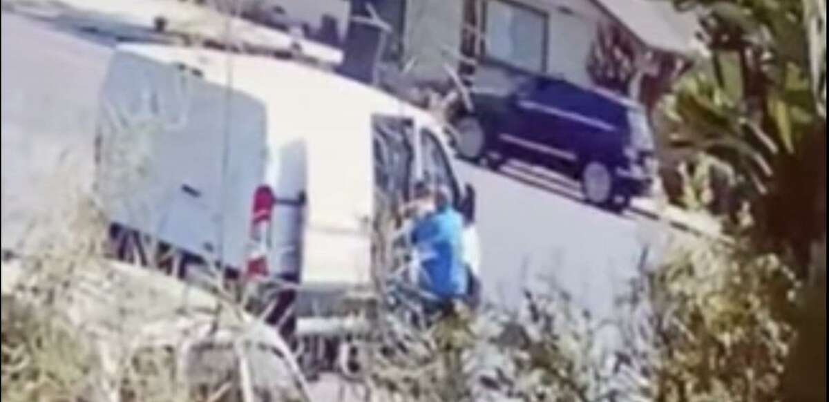 A screen shot of a video posted by the Campbell Police Department. Campbell police asked for the public's help as they investigate an incident showing a man apparently forcing a woman inside an allegedly stolen van.