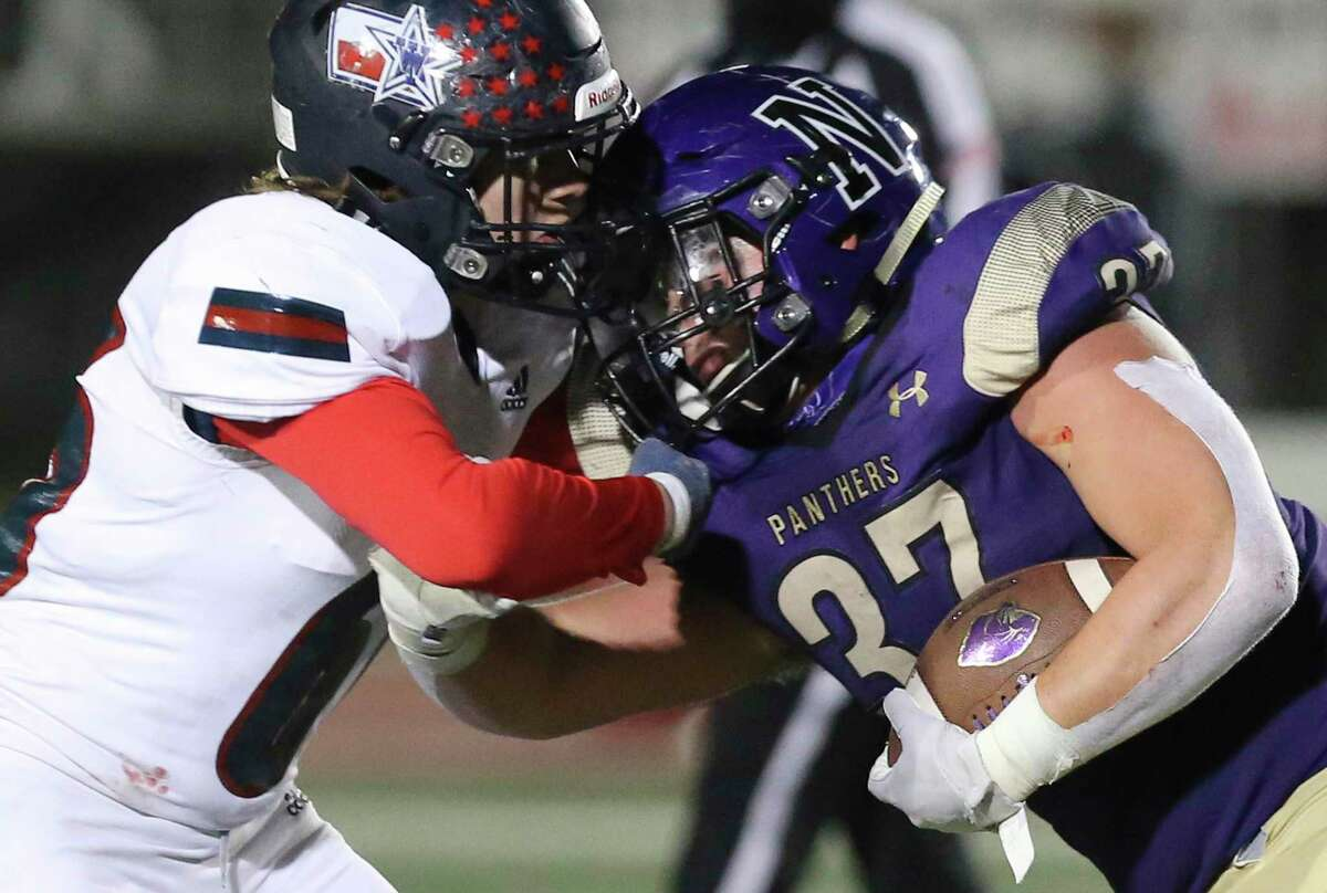 Wimberley Texans' Shay Shroyer (66) collides with Navarro Panthers' Brody Whitson (37) during their Class 4A Division II state quarterfinal football game in Boerne on Friday, Dec. 4, 2020.
