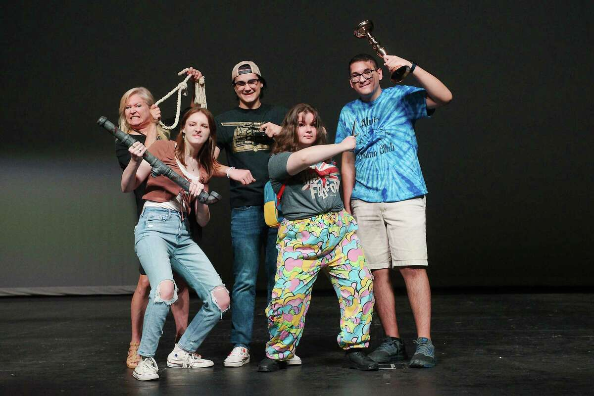 """Alvin High School theater arts teacher Laurie Wilson, left, and Alvin High School Drama Club/International Thespian Society student officers Devon Baxa, Noah Bryant, Jennifer Bozeman and Alex Blanco are preparing to stage """"Clue: On Stage (High School Edition)"""" on Sept. 30 and Oct. 1-2 at the Alvin ISD Performing Arts Center."""
