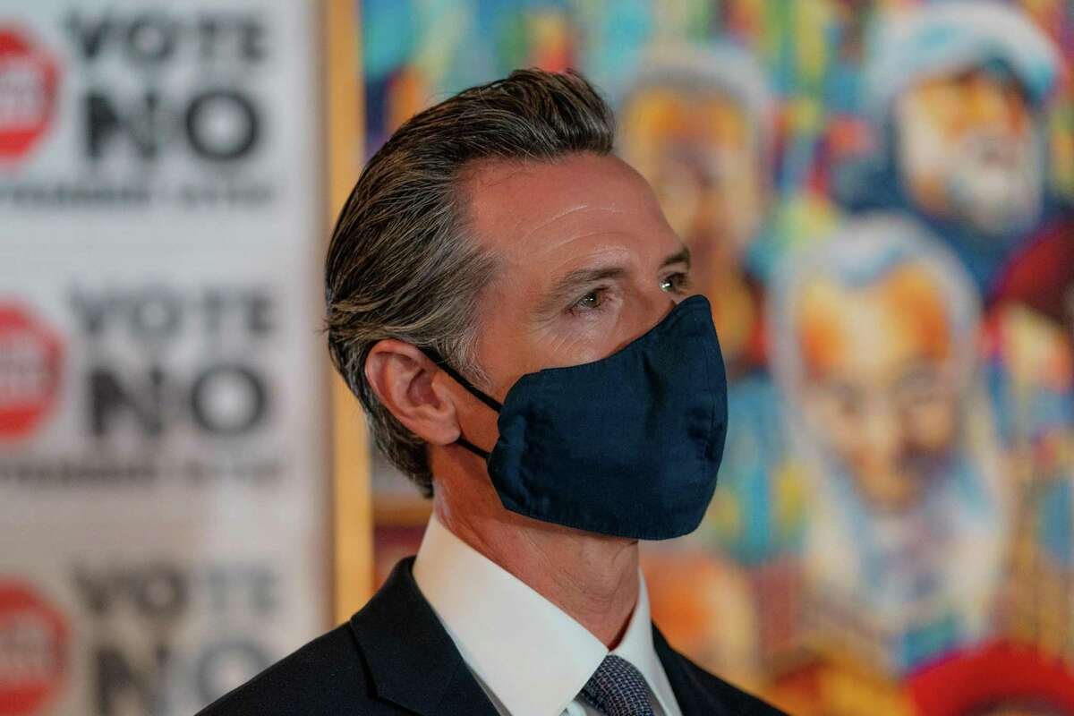 """California Gov. Gavin Newsom listens to others speakers during a press conference for his """"Vote No"""" campaign opposing his recall at Manny's in San Francisco on Friday, Aug. 13."""
