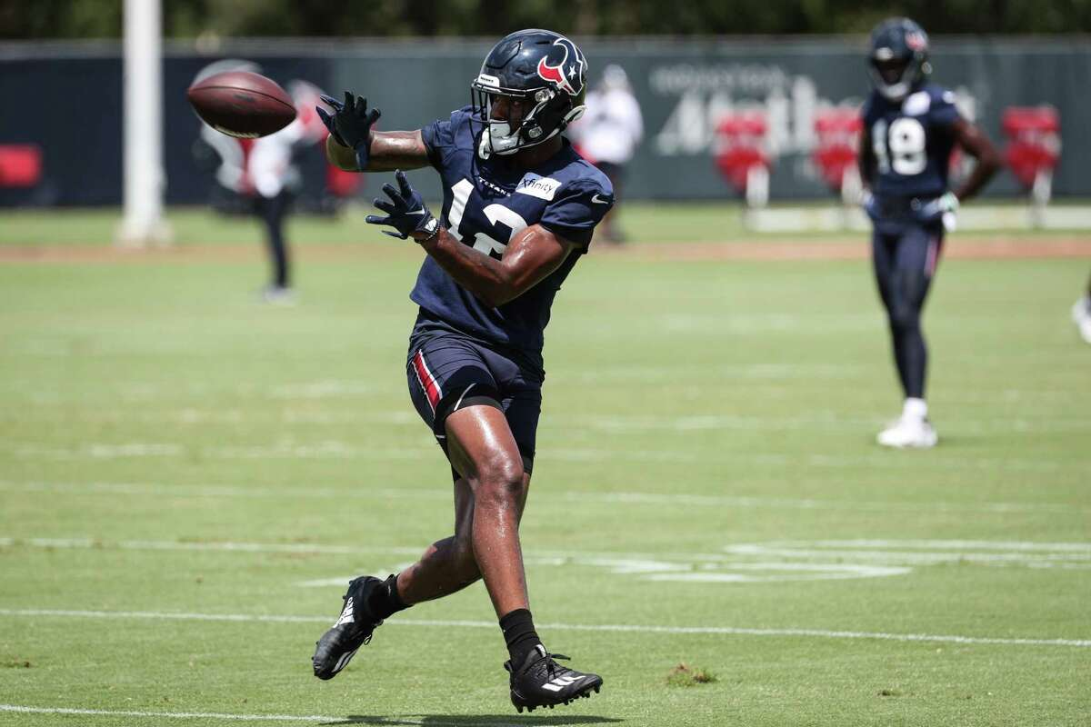 Houston Texans wide receiver Nico Collins reaches out to make a catch during an NFL training camp football practice Tuesday, Aug. 24, 2021, in Houston.