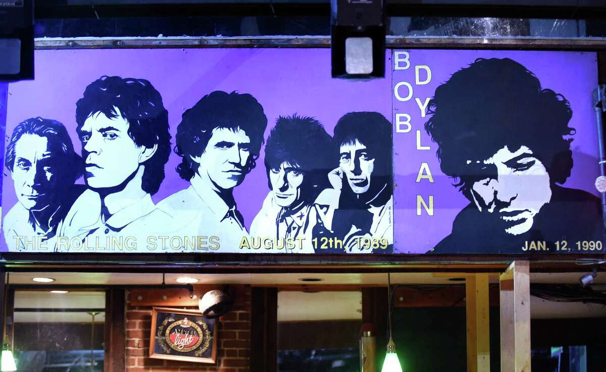 Rolling Stones and Bob Dylan paintings hang at Toad's Place in New Haven on February 1, 2018.