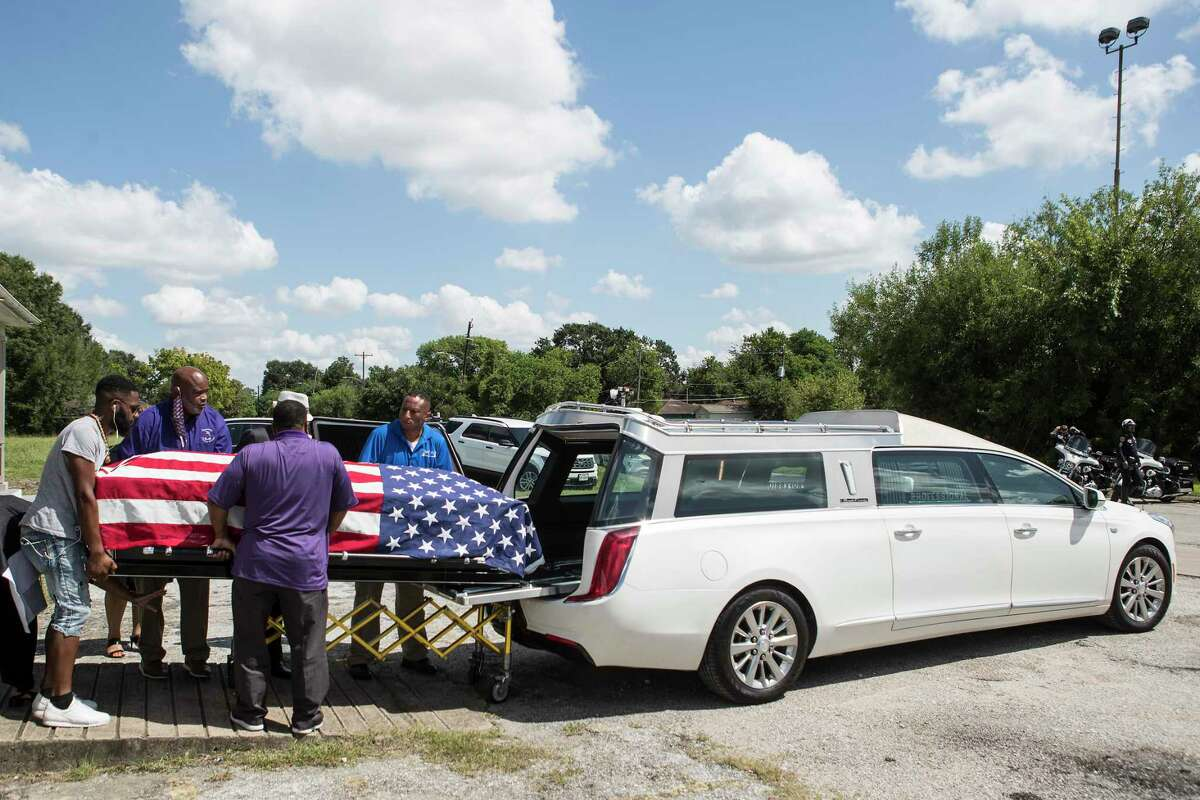 The body of New Orleans Police detective Everett Briscoe is escorted from the Respect for Life Funeral Home for the journey back to New Orleans on Tuesday, Aug. 24, 2021 in Houston. Briscoe was shot and killed Saturday at Grotto Ristorante during an attempted robbery while visiting Houston with his fraternity.