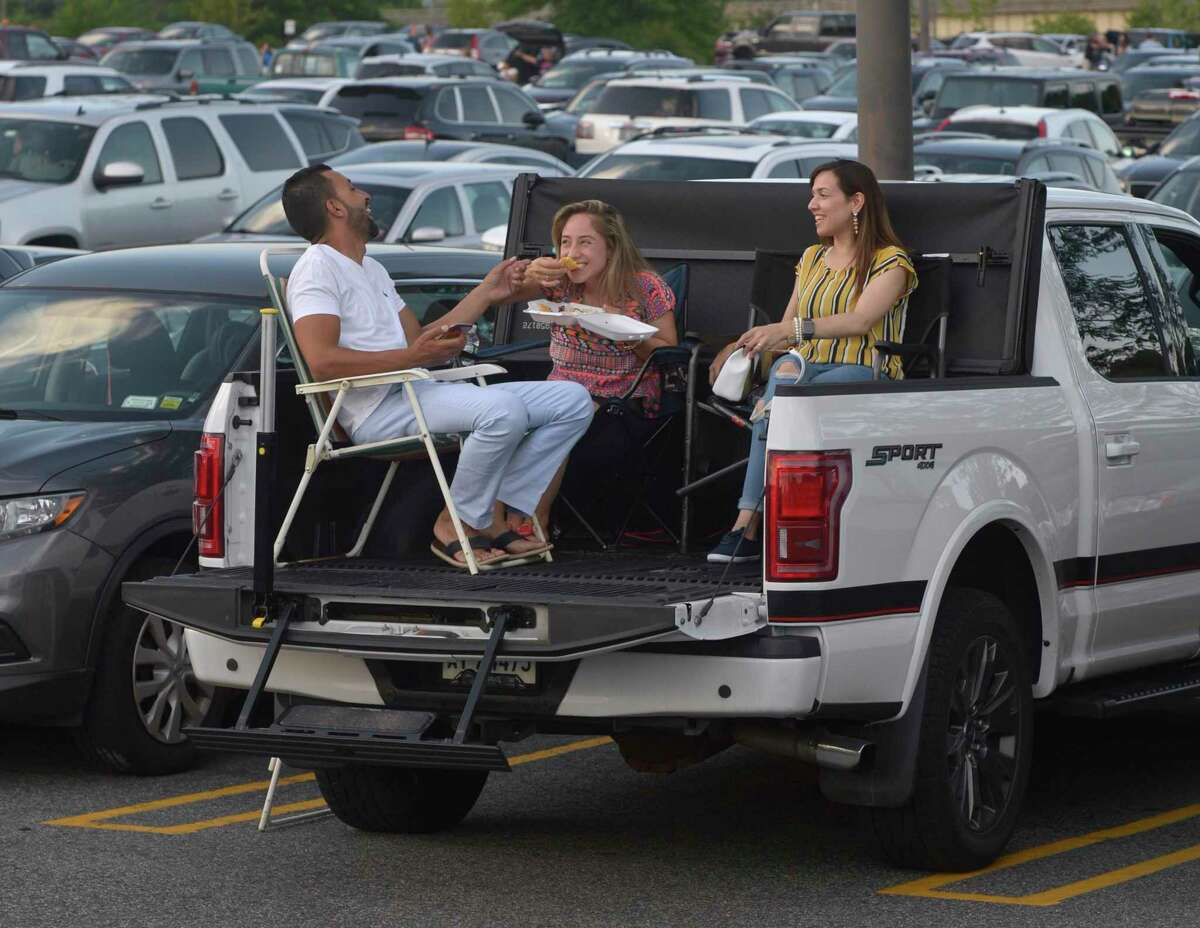 San Ramzy and Mayra Ramzy, left, of Brookfield, and Mona Ali, of Danbury, wait for the start of the Danbury Fair mall SummerStage Fireworks Show and Block Party. Wednesday, July 3, 2019, in Danbury, Conn. A fireworks celebration starts at 6 p.m. Friday, Sept. 3 at the mall.