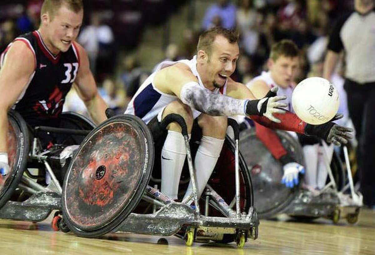 Godfrey resident Eric Newby of the U.S. Wheelchair Rugby team chases a loose ball during the 2015 Parapan Am Games. The U.S. team is in Tokyo and was set to open competition Wednesday morning in Japan, 9:30 p.m. Central Time in the United states.