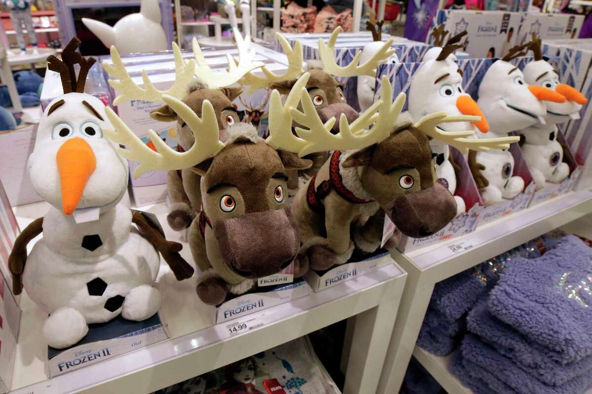 """Stuffed figures from the movie """"Frozen"""" on display at a """"Disney Store within a store"""" at a Target in Spring, Texas. Disney Store is closing dozens of locations nationally in September 2021, with parent company Walt Disney stating it will rely more on other retail stores carrying its merchandise along with online sales and theme park shops."""