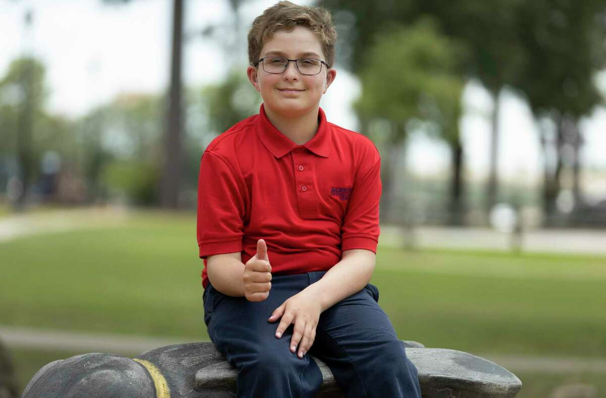 David Taylor, 10, poses for a portrait at Candy Cane Park, Thursday, Aug. 13, 2021, in Conroe. Taylor recently participated in the Johns Hopkins Center for Talented Youth and received High Honors and advanced scores in their verbal assessments despite severe hearing loss.