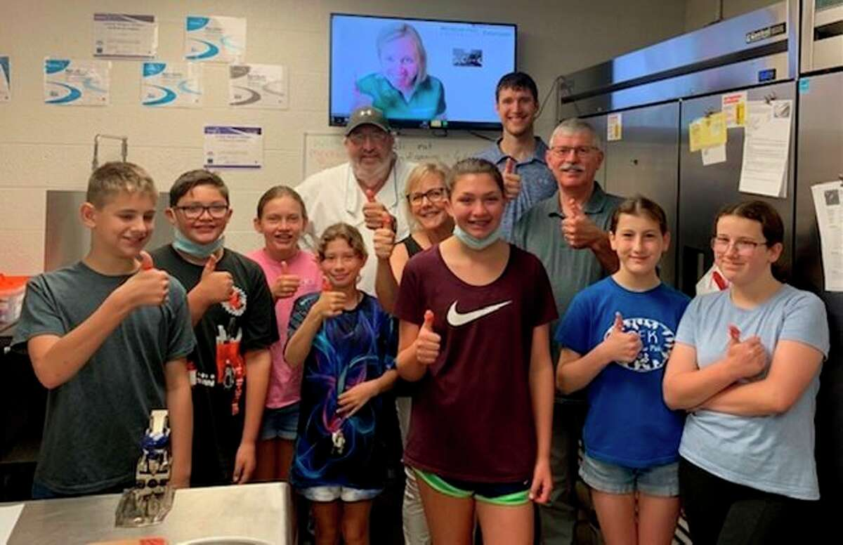 Matthew Knizacky and Joshua Gray, of the Knizacky Insurance Agency, pay a visit to a Cooking Matters for Teens class at the Armory Youth Project in Manistee. The agency awarded the AYP a $3,500 grant to support the program. (Courtesy photo)