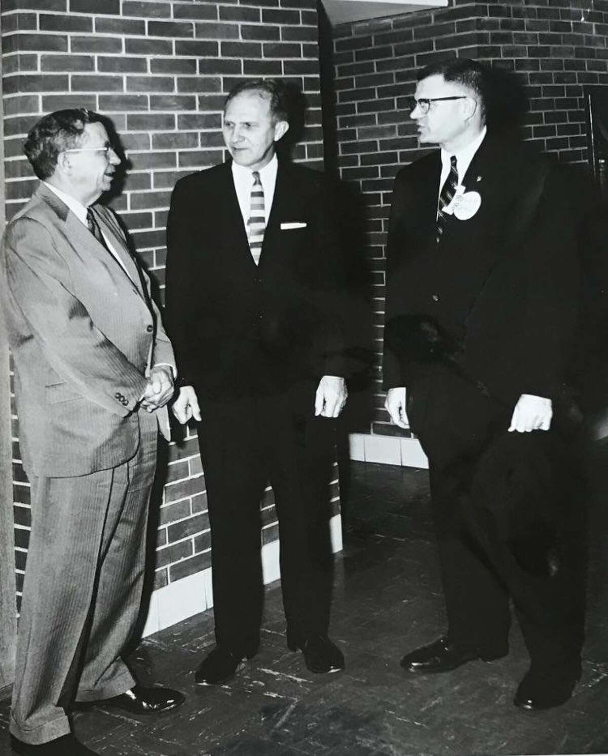Dr. Earl Kelley, left, of Wayne State University, was guest speaker at the 10th anniversary of Plymouth Elementary School. Pictured in center, Robert W. Davis, school principal, and Roger W. Bohl, program chair of the PTA. December 1964