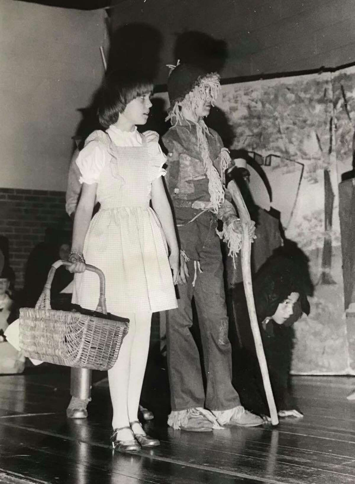 """Ruth Collins and her brother, David, practice their roles for """"The Wizard of Oz"""" at Plymouth Elementary School. Kneeling is Kevin Booth. April 1978"""